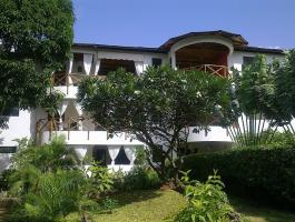 own a home in kenya's Coastal town of malindi.