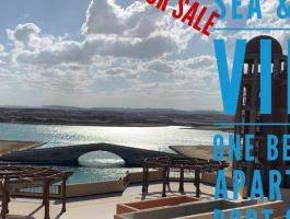 Unique opportunity - large one bedroom first floor with pool & sea view