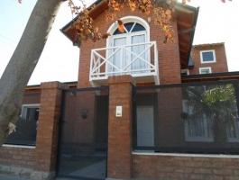 Dahir Real Estate & developer Sells House 4 Dorm. Plottier.
