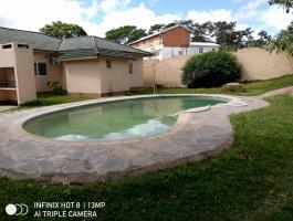 Four bedrooms stand alone house together with a coltage for rent